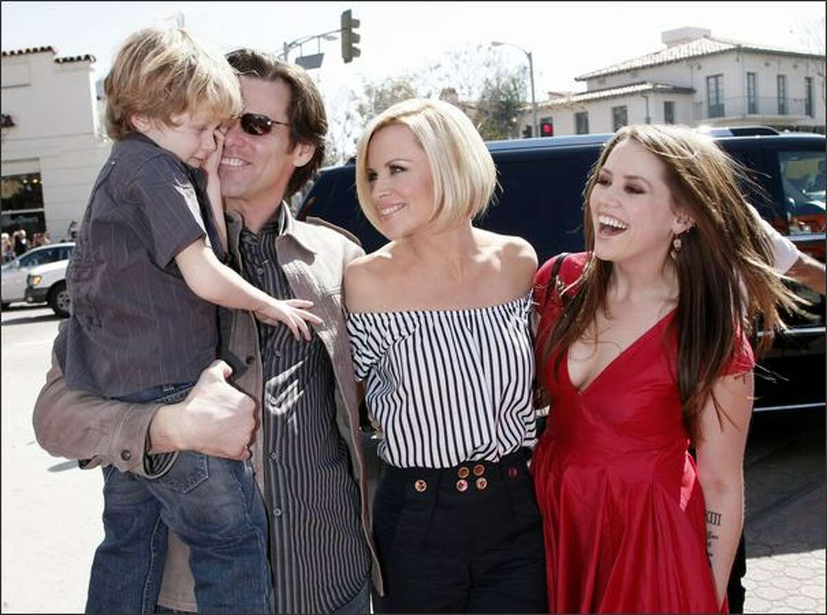 (L to R) Evan Asher, son of Jenny, actors Jim Carrey, Jenny McCarthy and Jim's daughter Jane Carrey arrive at the world premiere of 20th Century Fox's