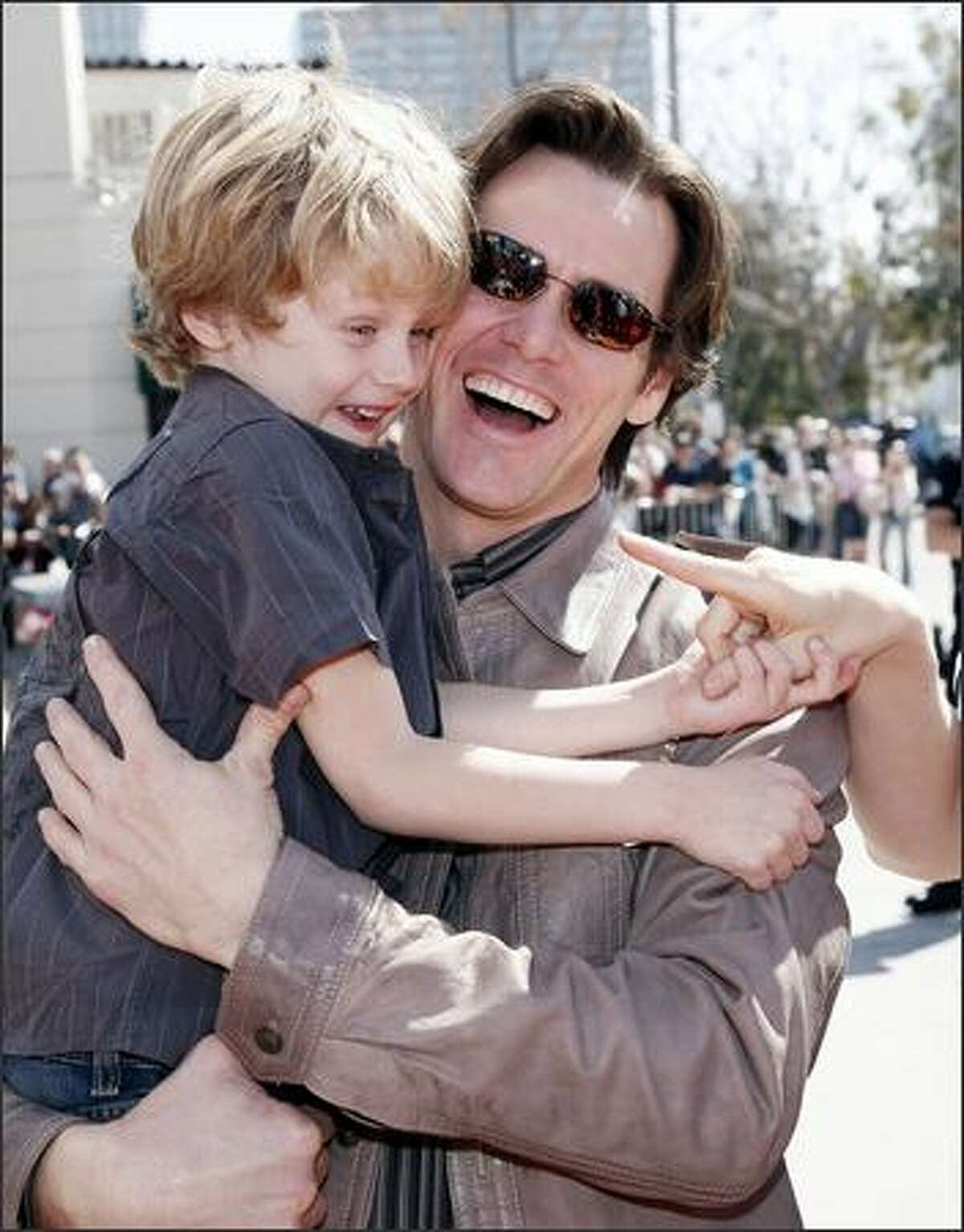 Actor Jim Carrey and Evan Asher, son of actress Jenny McCarthy, arrive at the world premiere of 20th Century Fox's