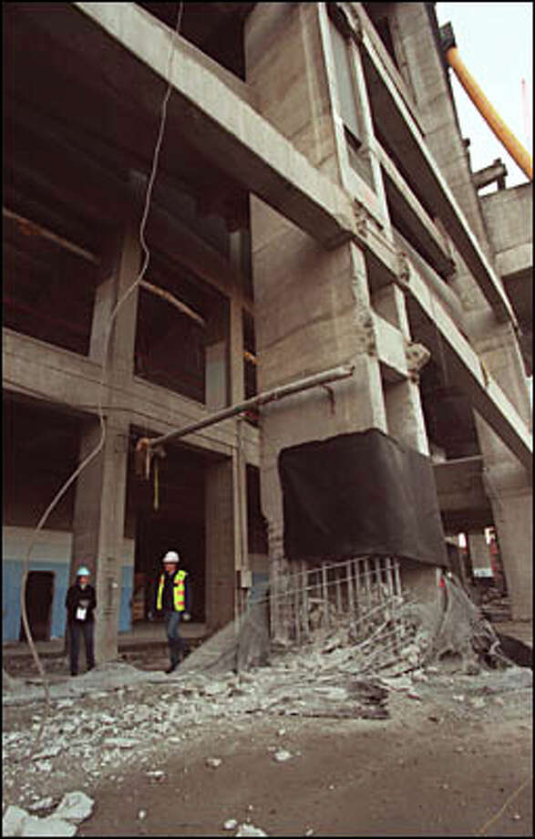 On Feb. 23, contractors conducted a test to see how much explosive would be needed to strip the concrete away from the massive rebar which helps support the Kingdome. Photo: Jeff Larsen, Seattle Post-Intelligencer
