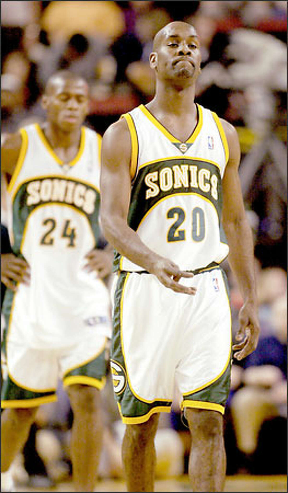 Sonics Gary Payton walks off the court with a frown on his face after a lackluster performance against the Suns.