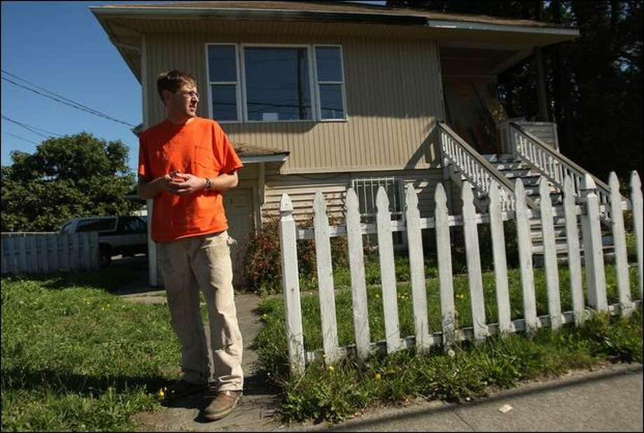 Paul Marshall stands Sunday in front of the home that he has been renting for about a year in the South Park area. The former asphalt plant nearby and the neighborhood around it was found to contain high levels of dioxin. Photo: Mike Kane/Seattle Post-Intelligencer