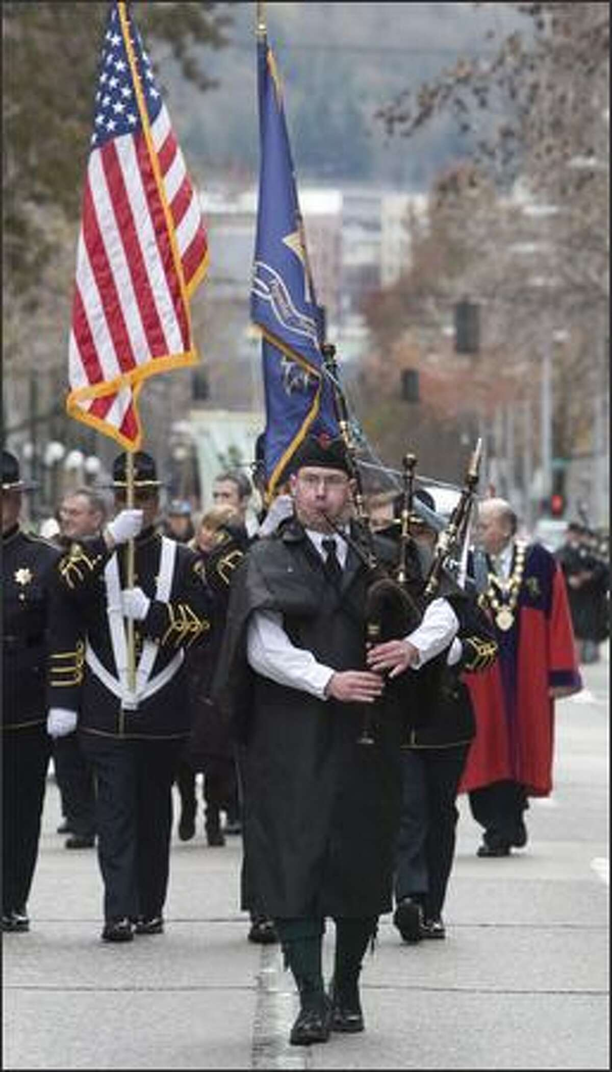 A bagpiper leads off the 37th annual St. Patrick's Day Parade in Seattle.