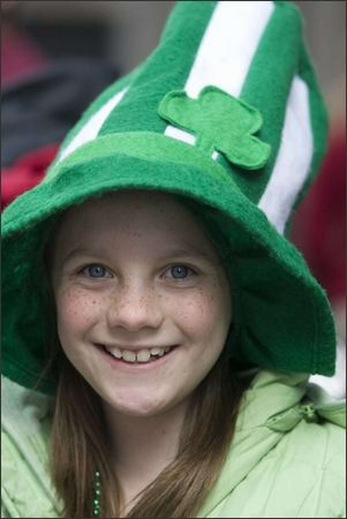 Elizabeth Nelson shows her Irish colors while watching the 37th annual St. Patrick's Day Parade Saturday in Seattle.