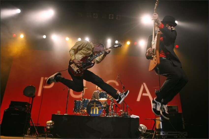 Chris Ballew and Andrew McKeag go airborne during the Presidents of the United States of America's Paramount Theatre show in Seattle.