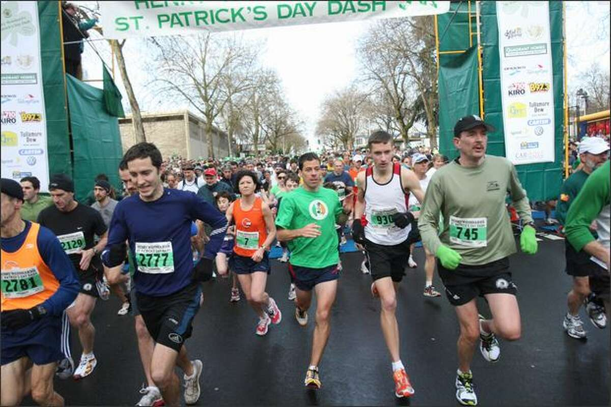 Runners explode off the starting line during the St. Patrick's Day Dash. The course is nearly 3.5 miles from Seattle Center to Qwest Field.