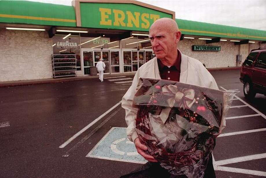 Ernst was a popular hardware store chain in Seattle, where one of its last remaining stores was in U Village. The store closed in 1997. Jack Hoag is pictured in front of the U Village store on Nov. 12, 1996, carrying a holiday wreath and feeling sad that the store was closing.  Photo: P-I File