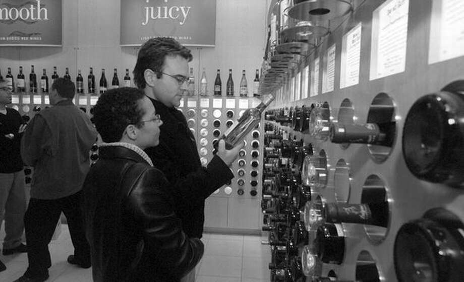 Here's the Best Cellars wine store in University Village in 1999, where all the wines were priced under $10. (Pictured are Shirley Andrews and Lewis Warren).  Photo: P-I File