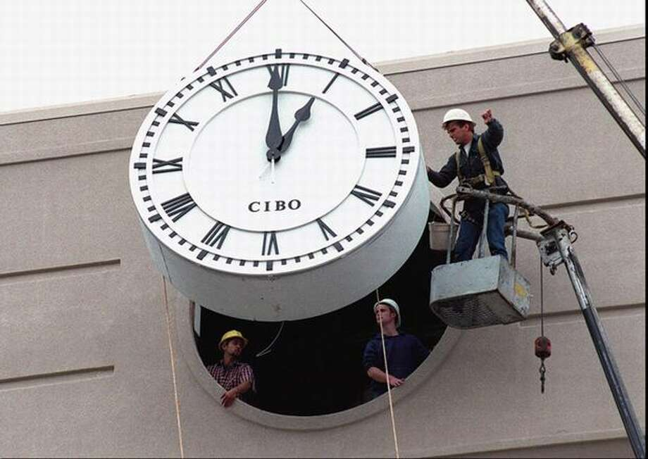 This giant clock was installed on a 70-foot tower at U Village on June 20, 1995, near Eddie Bauer, Barnes & Noble and Gap, which had recently opened. The stores opened in what used to be the old Lamonts store.  Photo: P-I File