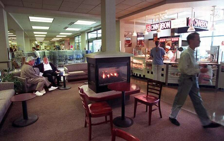 This is the interior of the U Village QFC in 1996. Yes, there was a Cinnabon there, and a cozy indoor fireplace.  Photo: P-I File