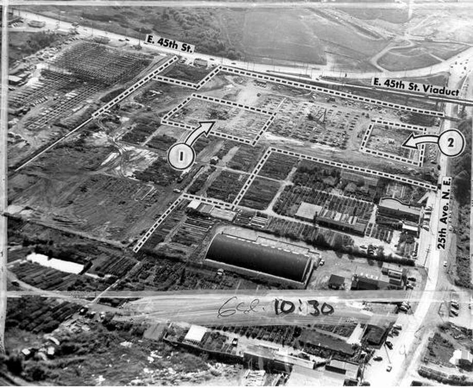 "The photo on this October 1955 photo: ""This interesting aerial photograph reveals what is happening on the 10-million-dollar, 22-acre University Village shopping area of the near future at 25th Ave. N.E. and E. 45th St. The foundation for Rhodes $3-million suburban department store is being built in Area No. 1, and the University branch of the Seattle Trust and Savings Bank is getting a start in Area 2.""""Room for parking of 2,000 automobiles is being made available in Area 3 and elsewhere on the property, which will have a number of diversified business establishments. Construction at upper left is new Carnation Co. building. At lower right is the roller rink, with rounded roof, and Malmo's Nursery."" Photo: P-I File"