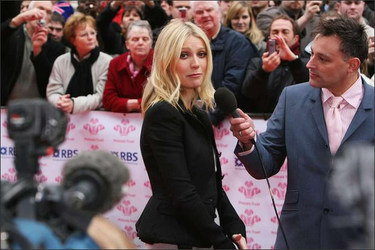 Actress Gwyneth Paltrow is interviewed as she arrives at the The Prince's Trust Celebrate Success Awards at the Odeon Leicester Square in London, England.