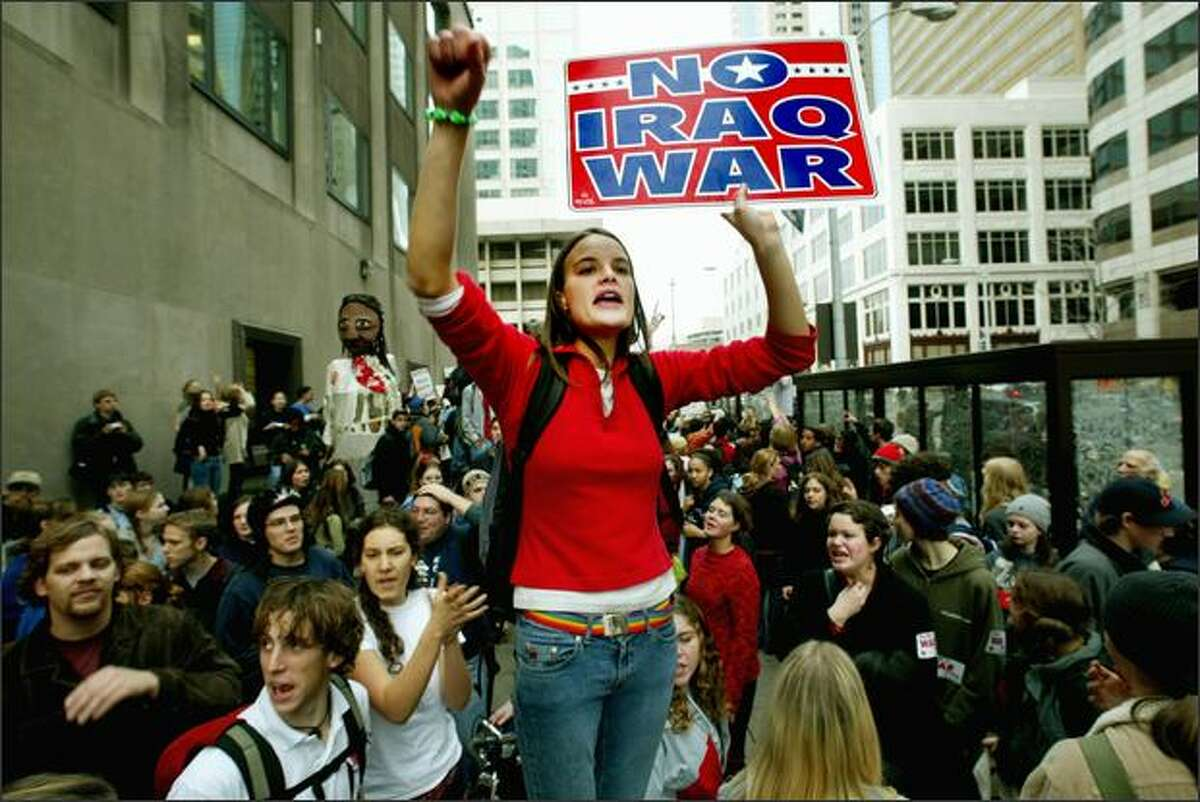 University of Washington student Emily Hicks was among the hundreds of students who protested the war on Iraq outside the Federal Reserve Building in downtown Seattle on December 5, 2002. The protesters were participating in the Student Walk-Out Against War.