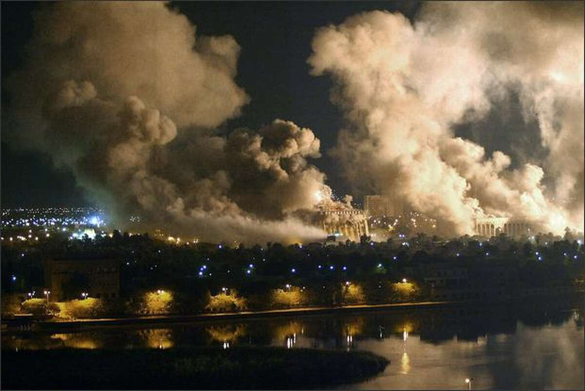 Smoke covers the presidential palace compound during a massive US-led air raid in Baghdad on March 21 2003. AFP PHOTO/Ramzi HAIDAR