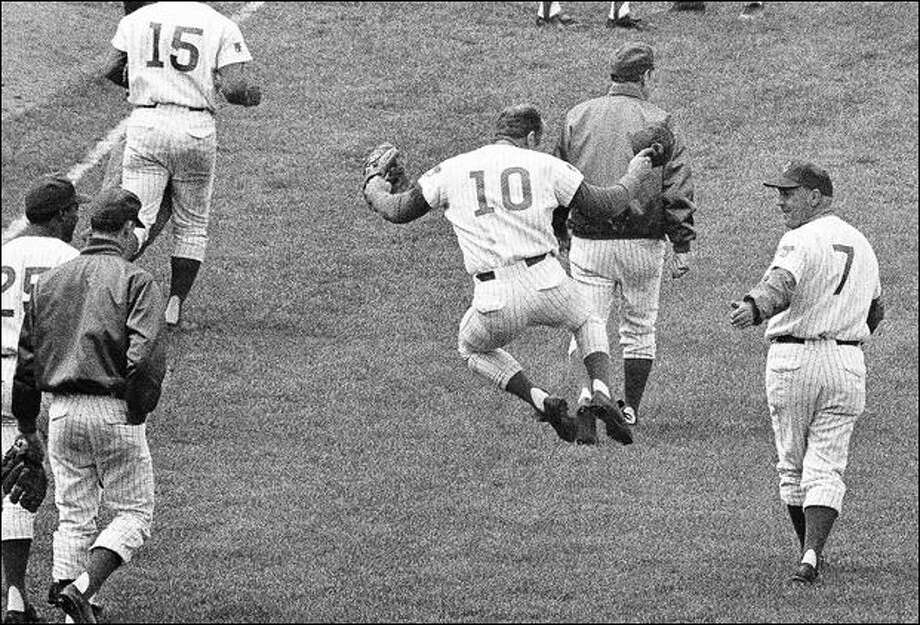 Cubs great Ron Santo, a Seattle native, clicks his heels en route to the locker room after his ninth-inning sacrifice fly gave Chicago a 5-4 win over Pittsburgh in 1969. Photo: The Associated Press/1969
