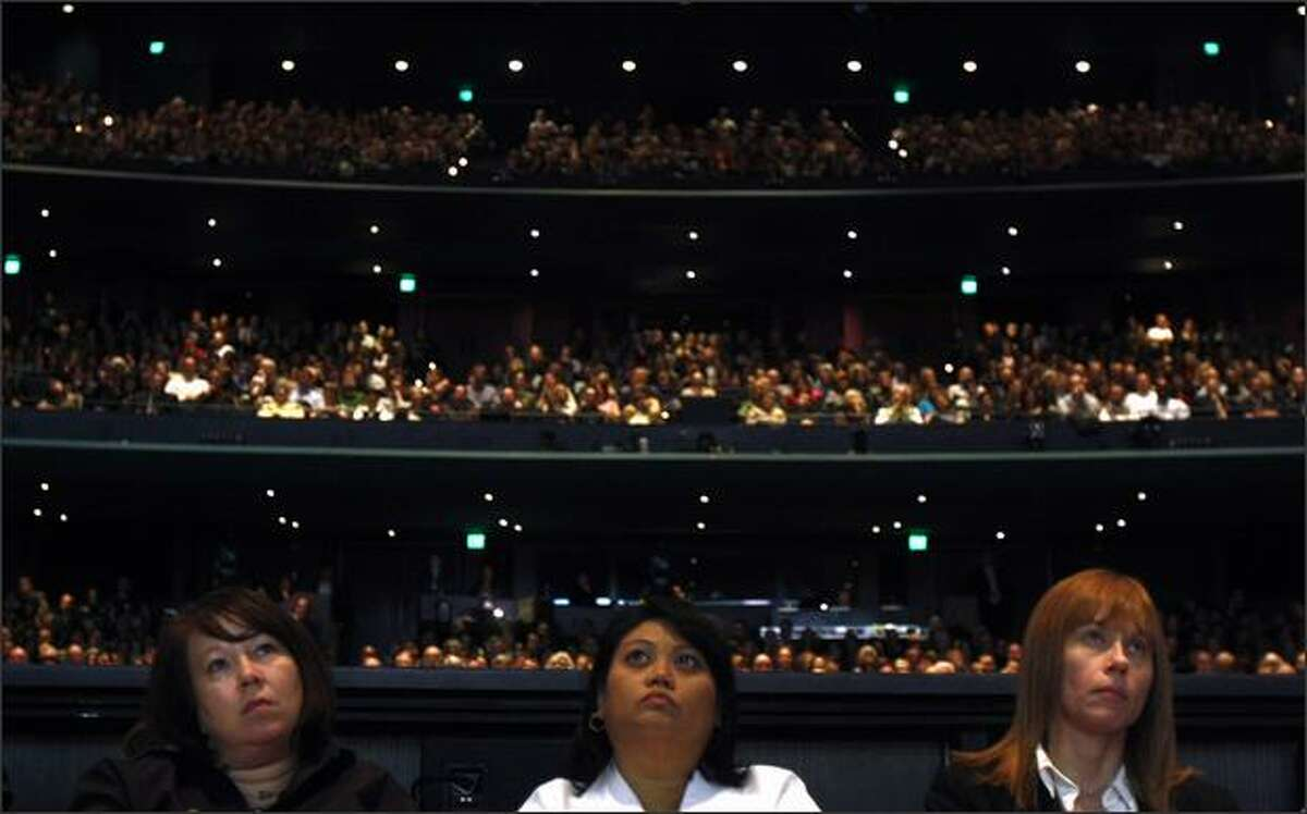 More than 6,000 shareholders gathered at McCaw Hall in Seattle listen as Starbucks chairman, president and CEO Howard Schultz speaks during the company's Annual Meeting of Shareholders. Schultz announced 6 new initiatives intended to invigorate the company's languishing U.S. business.