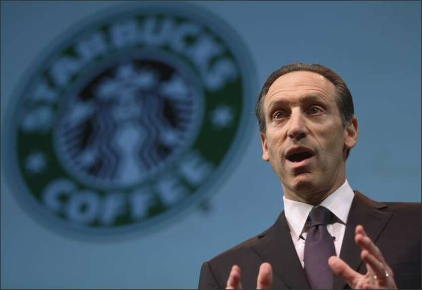 Starbucks chairman, president and CEO Howard Schultz addresses more than 6,000 shareholders gathered at McCaw Hall in Seattle for the company's Annual Meeting of Shareholders. Schultz announced 6 new initiatives intended to invigorate the company's languishing U.S. business.
