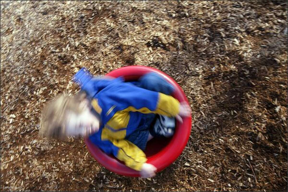 Sebastion Stillion, two years old, from Edmonds, Wash., enjoys a spin in a