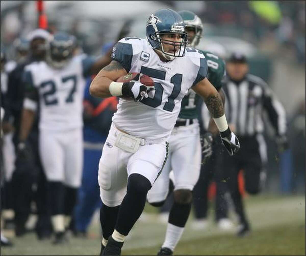Seattle Seahawks linebacker Lofa Tatupu returns an interception, his first of three off Philadelphia Eagles quarterback A.J. Feeley, for 33 yards in the first play of scrimmage in the 1st quarter at Lincoln Financial Field in Philadelphia on Sunday, December 2, 2007.