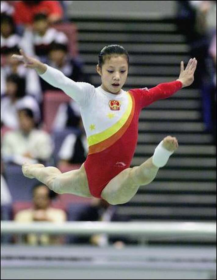 Chinese gymnast Dong Fangxiao competes at the East Asian Games in Osaka, Japan in 2001. Dong is one of two members of the Chinese team at the 2000 Sydney Olympics suspected of having been underage. Photo: Kazuhiro Nogi/Afp/Getty Images