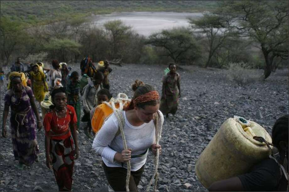 Sarah Stuteville, with Dillo water walkers on the walk out of salt crater. photos by Alex Stonehill
