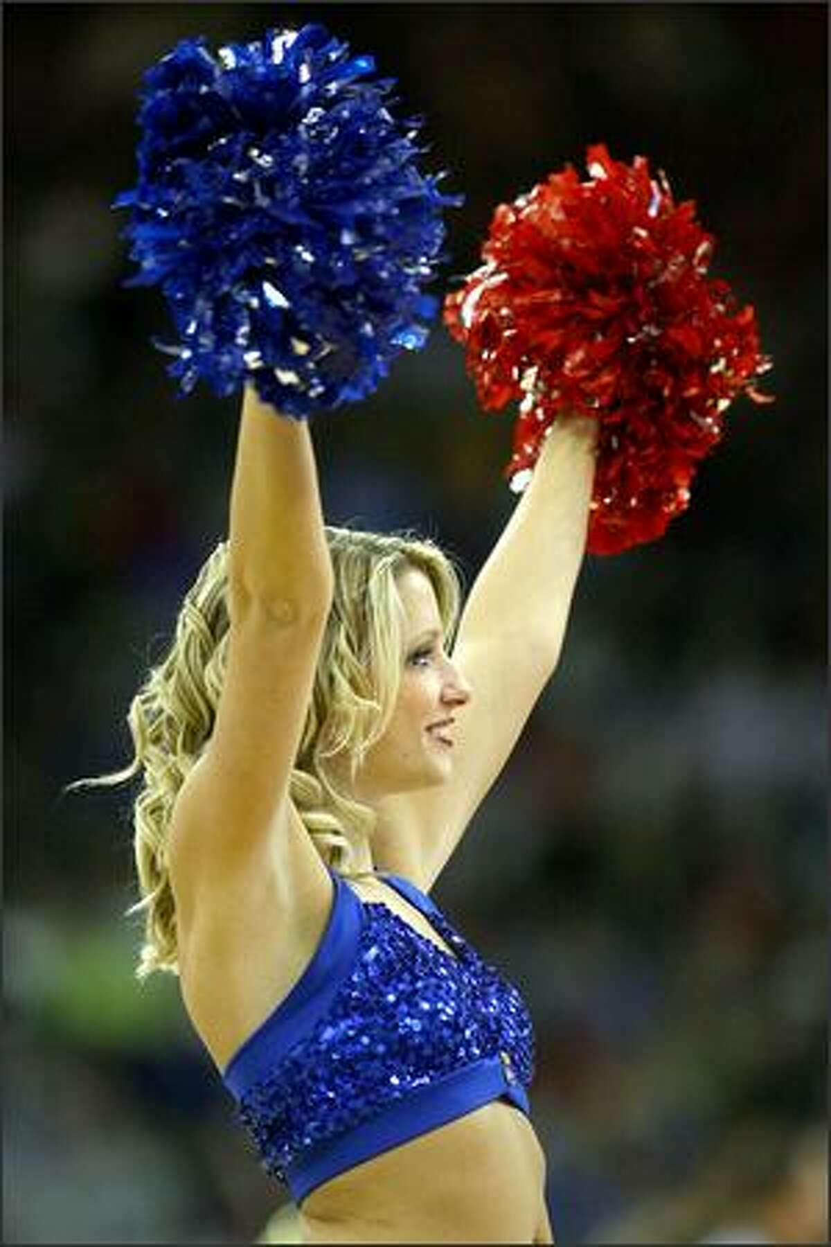 A cheerleader for the Kansas Jayhawks performs during the Midwest Region second round game against the UNLV Runnin' Rebels at the Qwest Center in Omaha, Neb.