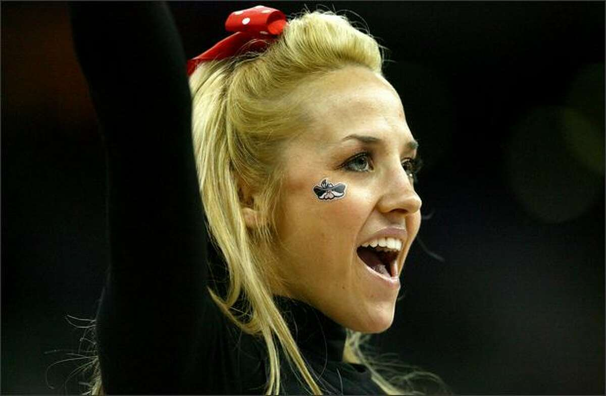 A cheerleader for the UNLV Runnin' Rebels performs at the Qwest Center in Omaha, Neb.