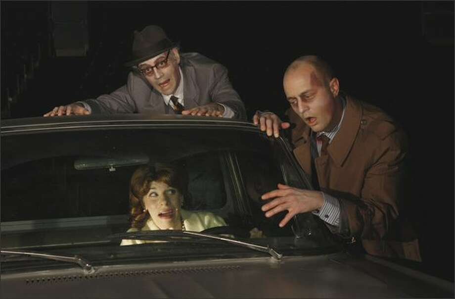 Zombies (Troy Fischnaller, left, and Galen Joseph Osier) hassle Barbara (Sarah Harlett). Photo: Chris Bennion