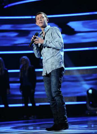 "In this publicity image released by Fox, Scotty McCreery performs on the singing competition series ""American Idol,"" on Wednesday, March 9, 2011, in Los Angeles. Photo: AP"