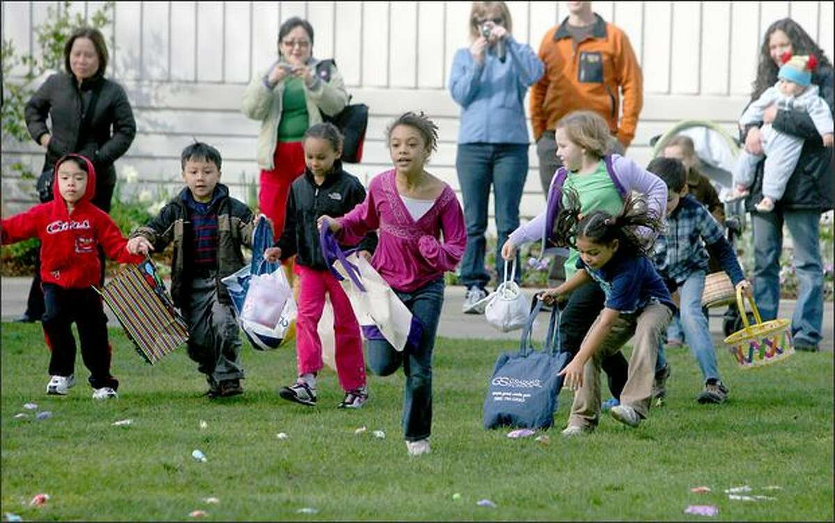 The 7-11 year-olds make the dash for the goodies during the egg hunt at the Green Lake Community Center on Saturday March 22, 2008 in Seattle