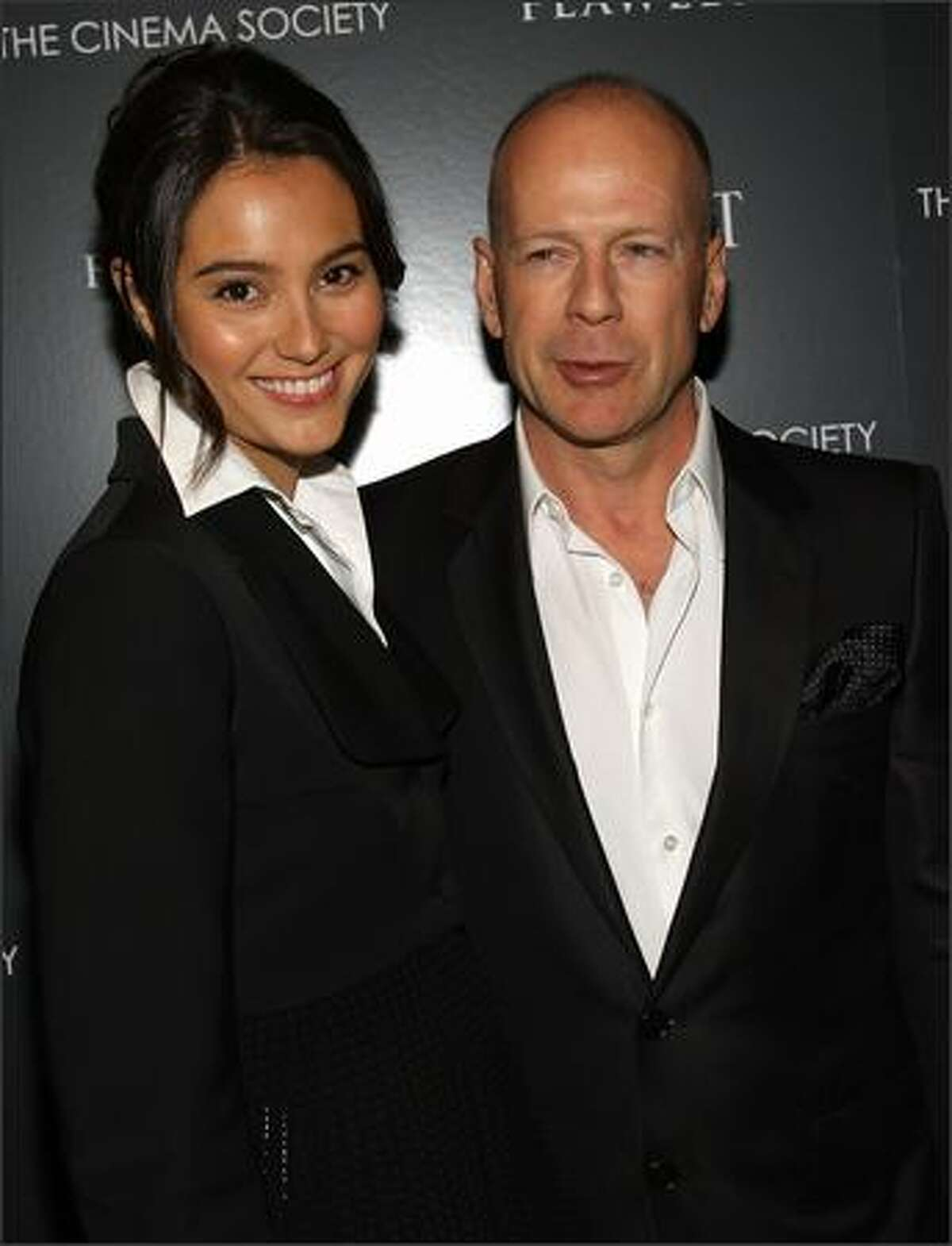 Actors Emma Hemming and Bruce Willis attend