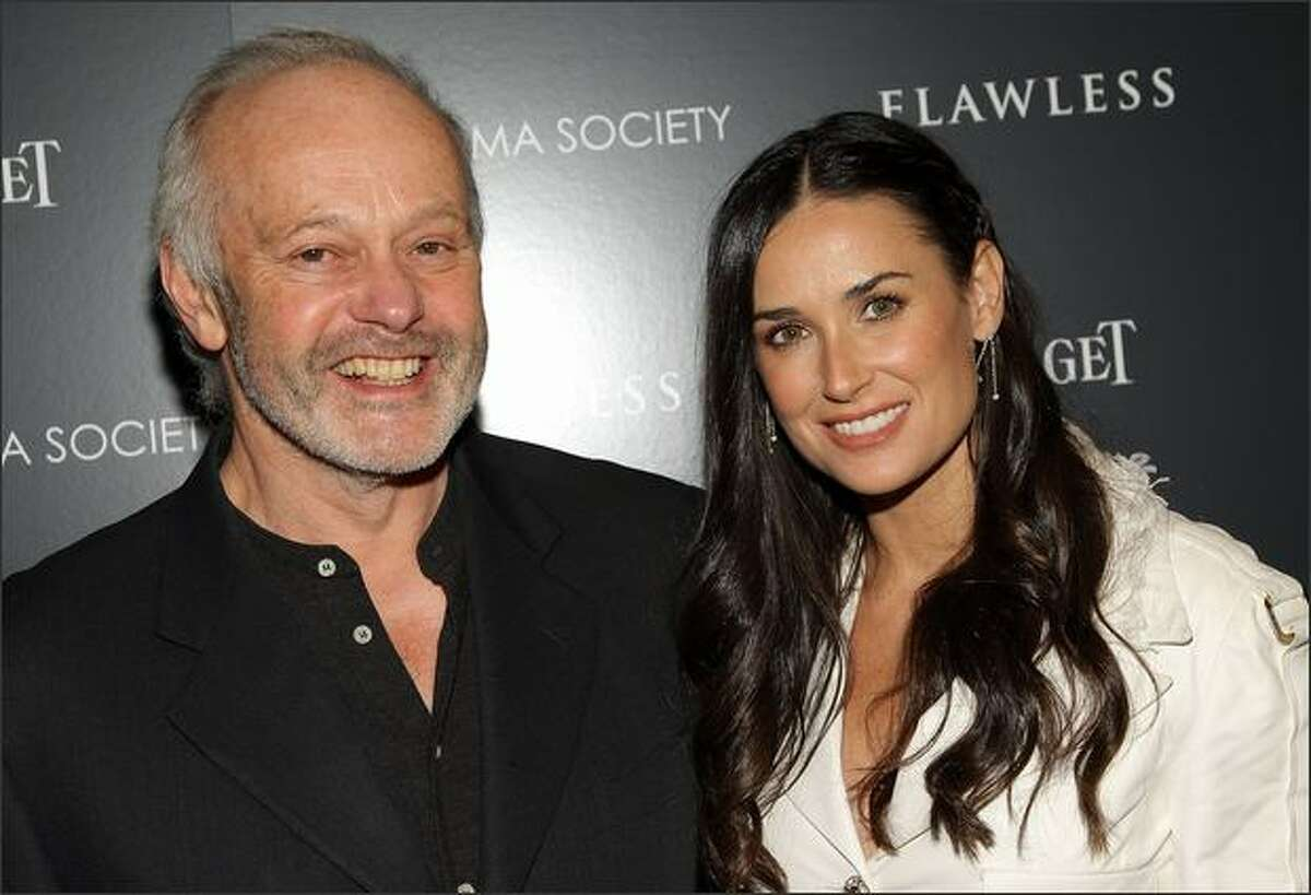 Director Michael Radford and actress Demi Moore attend