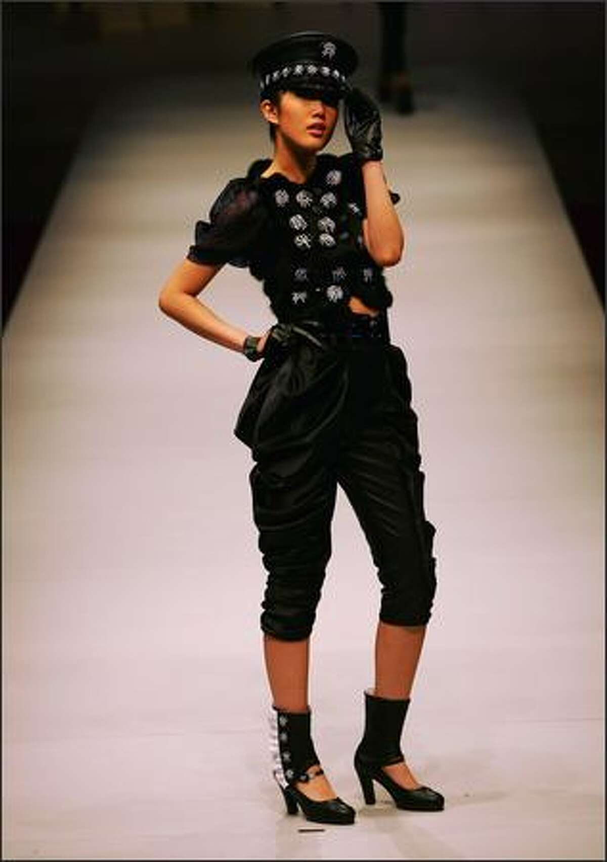A model walks the runway during the China Fashion Week 2008/2009 Collection Autumn/Winter on March 25, 2008 in Beijing, China.