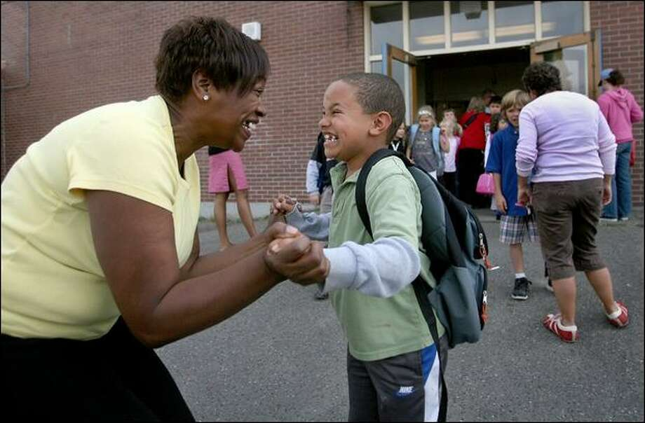 Sherelyn Anderson picks up her son, Josh, 7, at Alki Elementary in Seattle on Wednesday. Anderson recently earned a degree in criminal justice at Seattle University. Photo: Scott Eklund/Seattle Post-Intelligencer