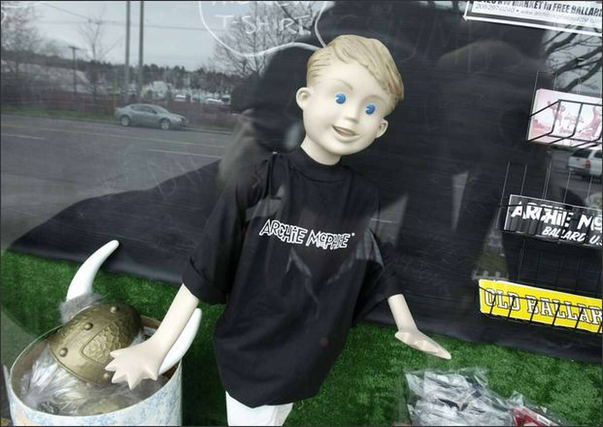A mannequin in an Archie McPhee t-shirt greets those passing by the display window of the Ballard store in Seattle.