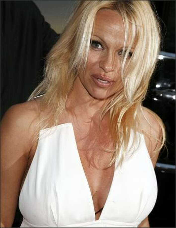 "Actress Pamela Anderson arrives at the premiere of Dimension Film's ""Superhero Movie"" at the Mann Festival Westwood on Thursday in Los Angeles, Calif. Photo: Getty Images"