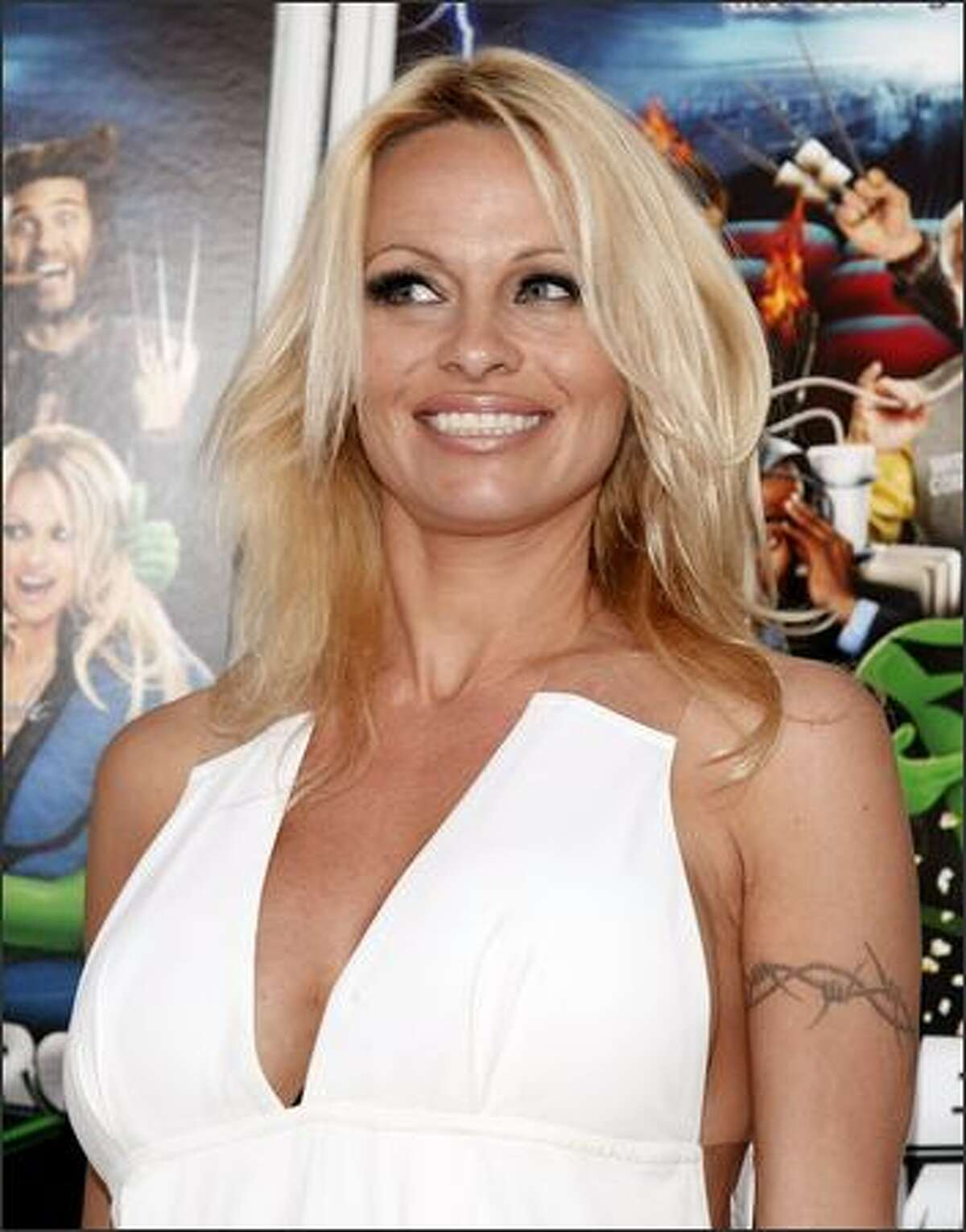 Actress Pamela Anderson arrives at the premiere of Dimension Film's