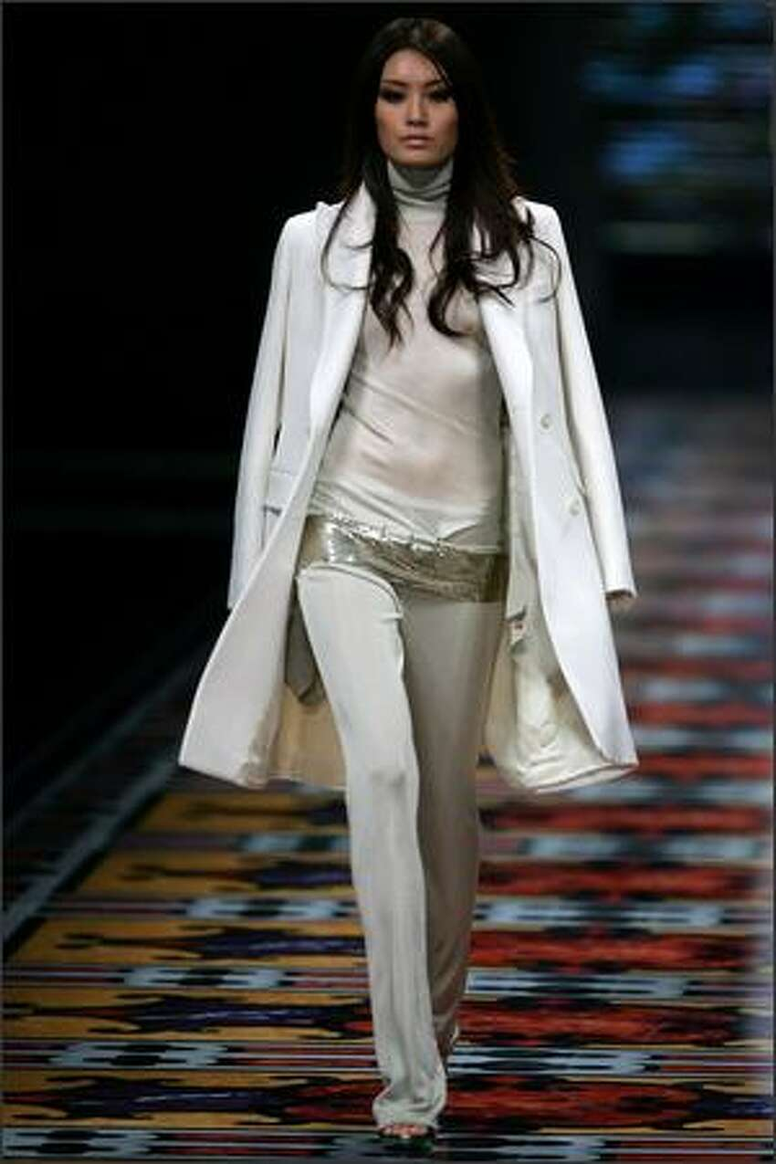 A model walks the runway during the Women's and Men's Autumn-Winter 2008 Fashion Show of Italian brand Salvatore Ferragamo at Shanghai Port International Cruise Terminal on Friday in Shanghai, China.