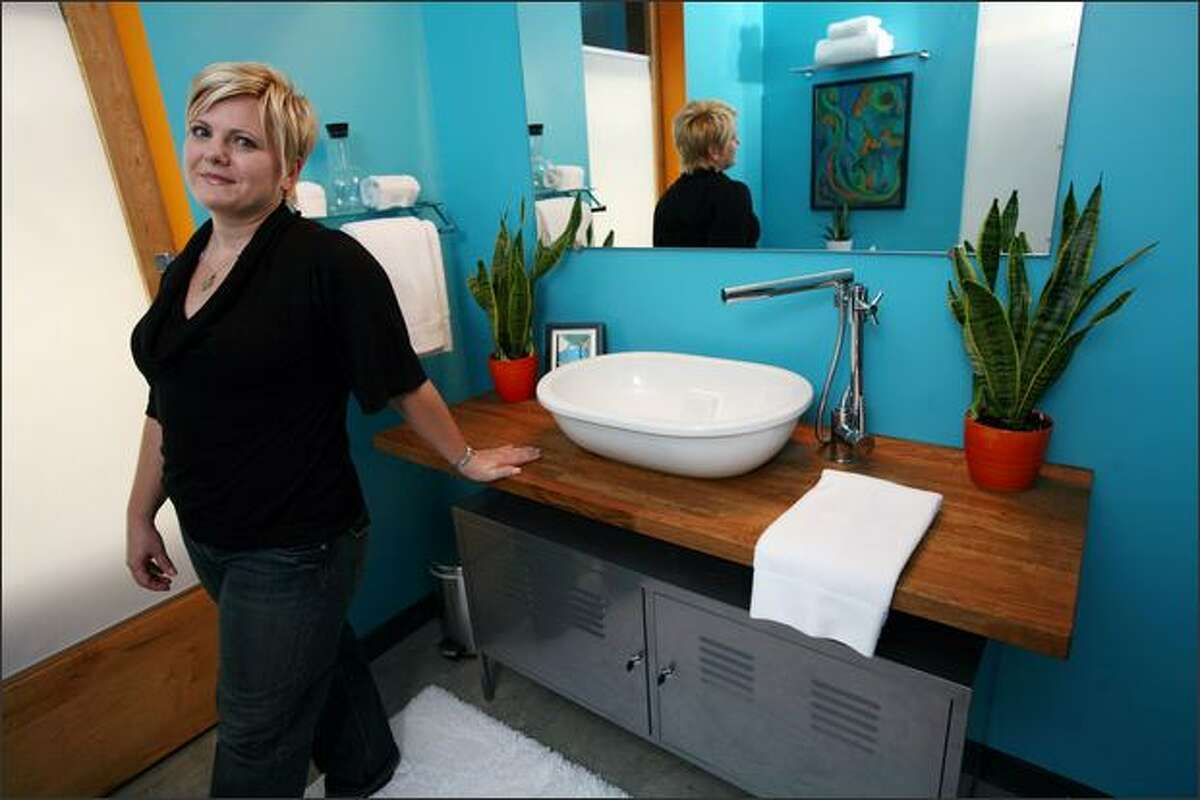 Lara Holland, at home in Mound, Minn. Holland takes IKEA furniture and repurposes it into other things, like the vanity/cabinet in her bathroom. Allen Brisson-Smith/The New York Times