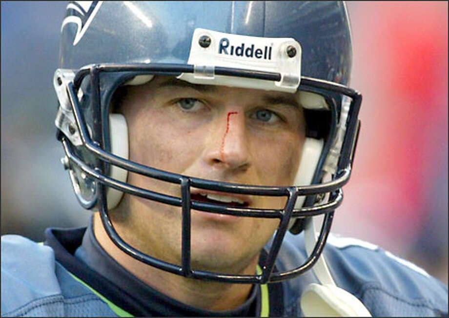 Blood runs down the nose of Seahawks quarterback Matt Hasselbeck late in the game. Hasselbeck passed for 264 yards, but fumbled twice and was sacked four times. Photo: Dan DeLong, Seattle Post-Intelligencer