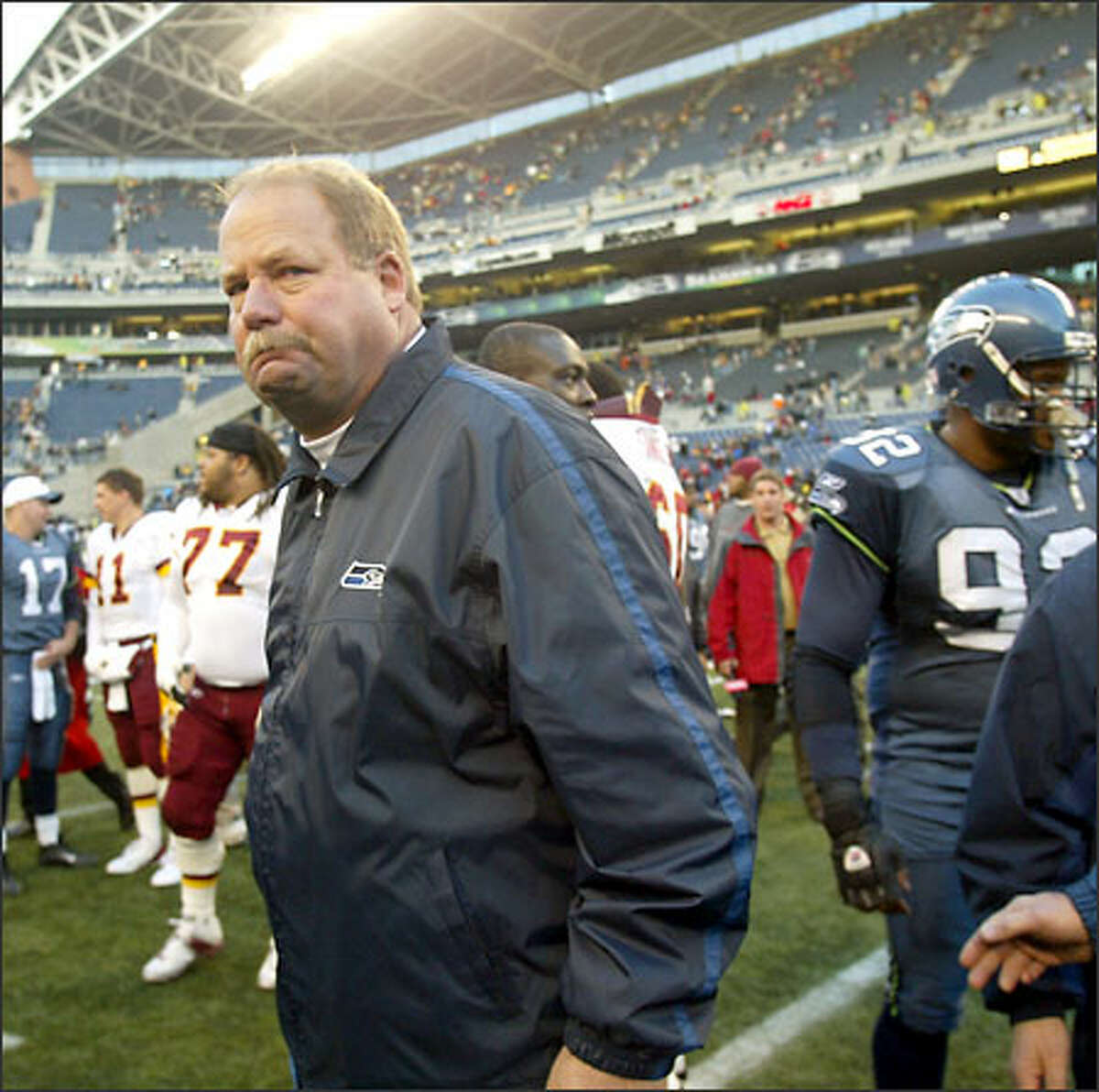 A sour Mike Holmgren walks off the field after the Seahawks' loss to Washington dropped his team to 2-6 at the midpoint of the NFL season.
