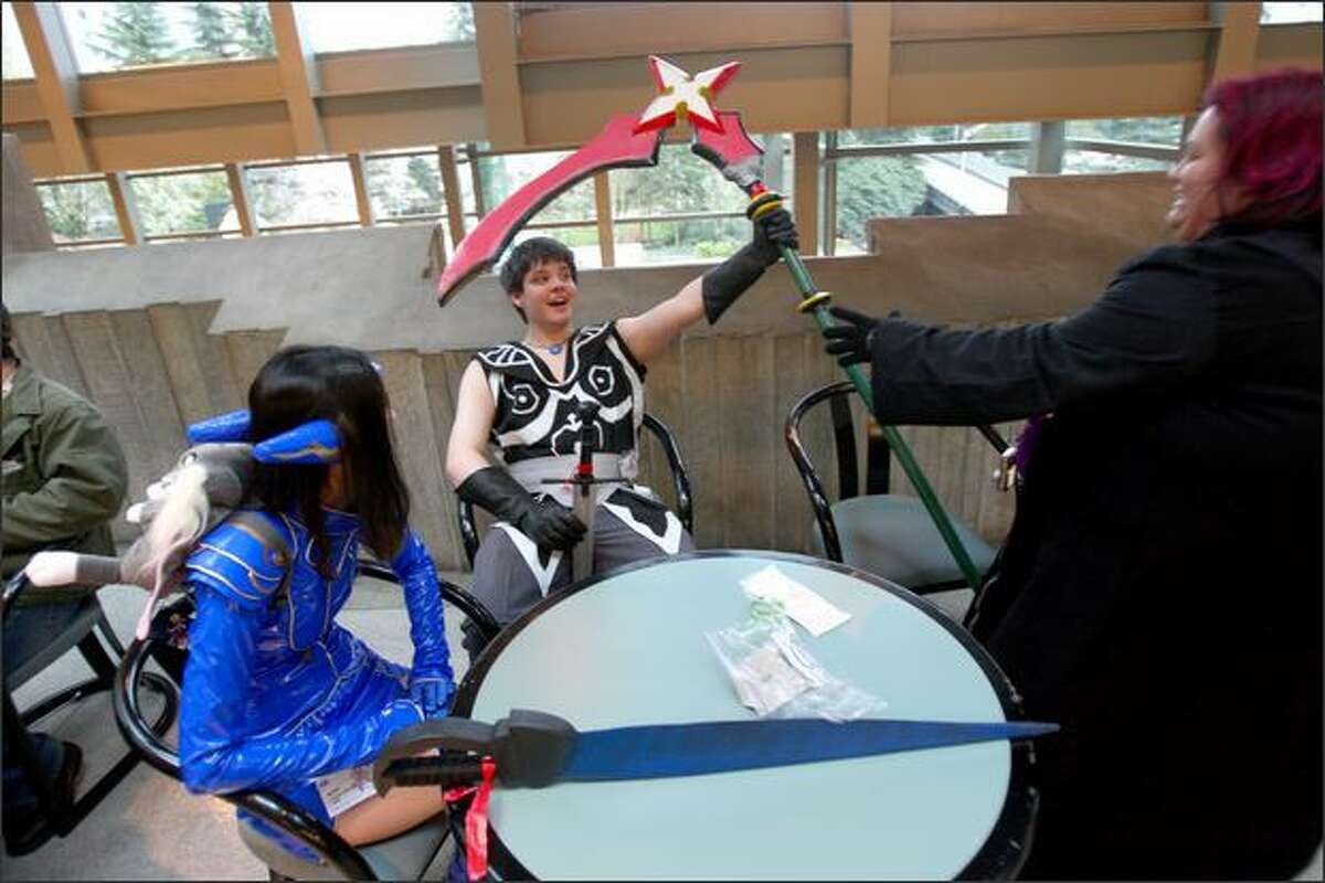 Convention attendees, from left, Shannon McLeod, Michael Hooker and Roxanne Lamm take a break during Sakura-Con.