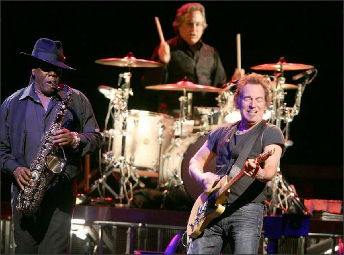 Bruce Springsteen performs with the E Street Band, including saxophonist Clarence Clemmons (left) and drummer Max Weinberg.