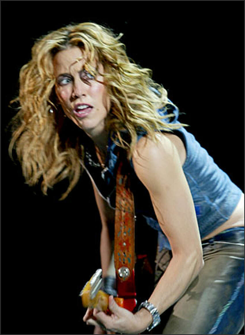 American rocker Sheryl Crow belts out some hot licks herself as she opens for the Rolling Stones on the British band's