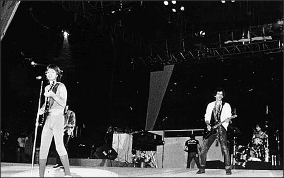 Mick Jagger, left, and Keith Richards led the Rolling Stones at a concert in the Kingdome Oct. 14, 1981. Photo: P-I File