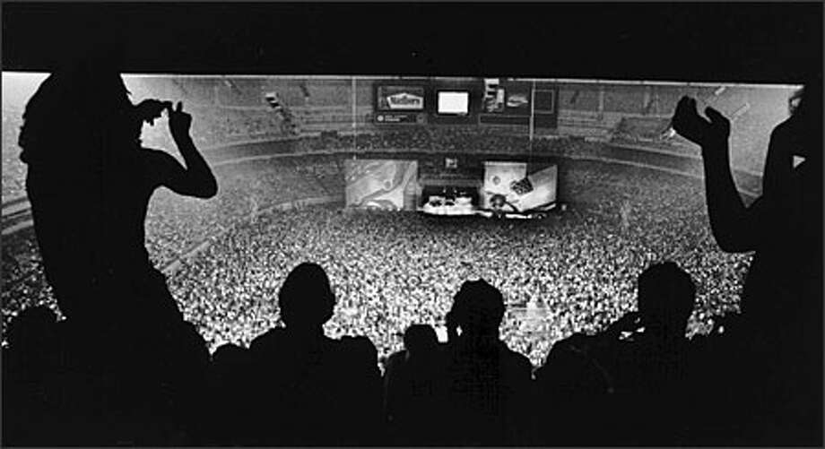 Fans dance to the Rolling Stones at the 300 level of the Kingdome, the highest seats in the house, back in 1981. Photo: P-I File