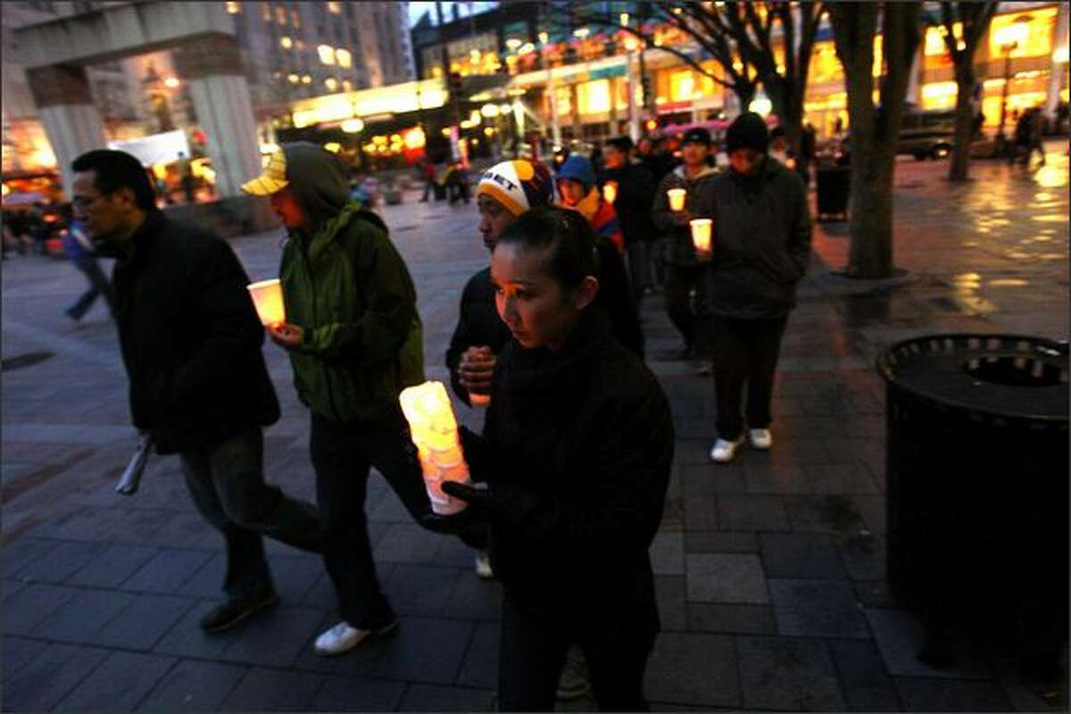 Tibet supporters participate in a candle light vigil and prayer march at Westlake Plaza in Seattle on the declared world-wide day of Support for Tibet, the day that the Olympic Torch arrives in Beijing. The event was sponsored by the Tibetan Association of Washington.