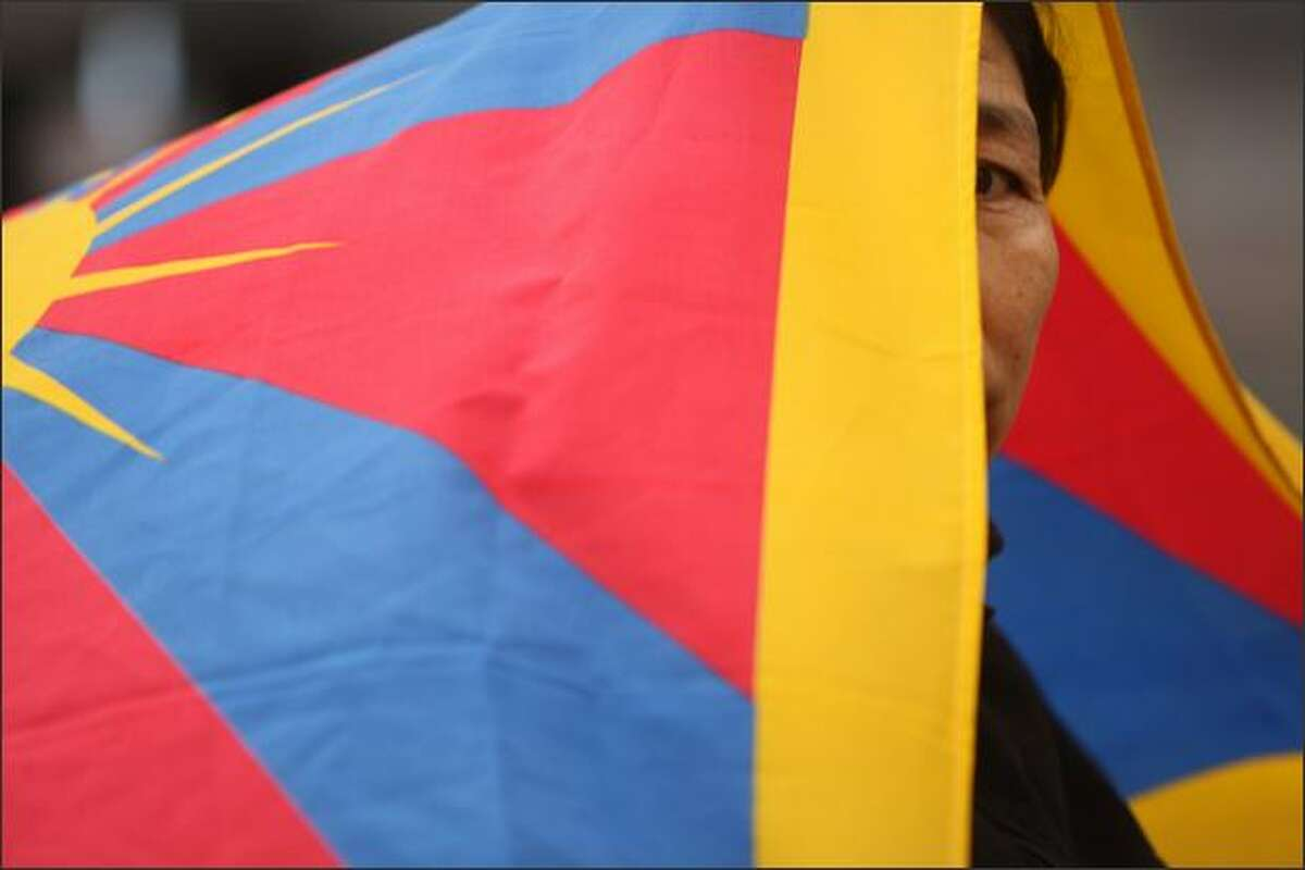 Nage Batui, of Seattle, joins other Tibet supporters during a candle light vigil at Westlake Plaza in Seattle on the declared world-wide day of Support for Tibet, the day that the Olympic Torch arrives in Beijing. The event was sponsored by the Tibetan Association of Washington.