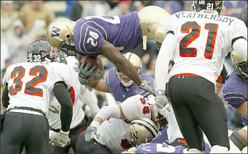 Here Rich Alexis (24) dives over the Oregon line to score a touchdown in the second quarter.