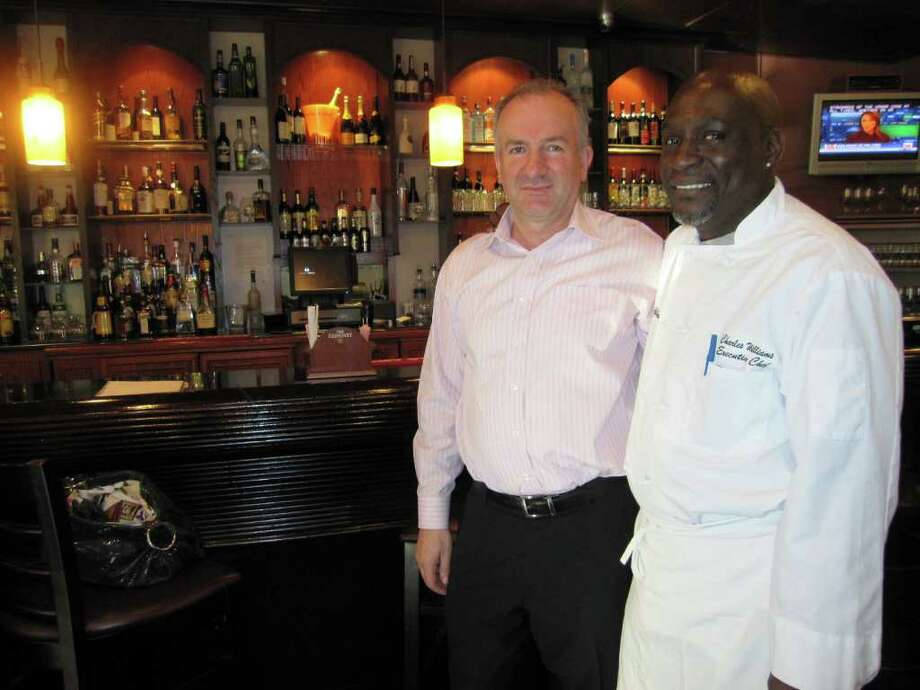 Iso Dedusaj, left, the owner/manager of the Fairfield Cafe, and chef Charles Williams, will provide some of the foods showcased at the April 7 Spring Fling sponsored by the Fairfield Chamber of Commerce. Photo: Contributed Photo / Fairfield Citizen contributed