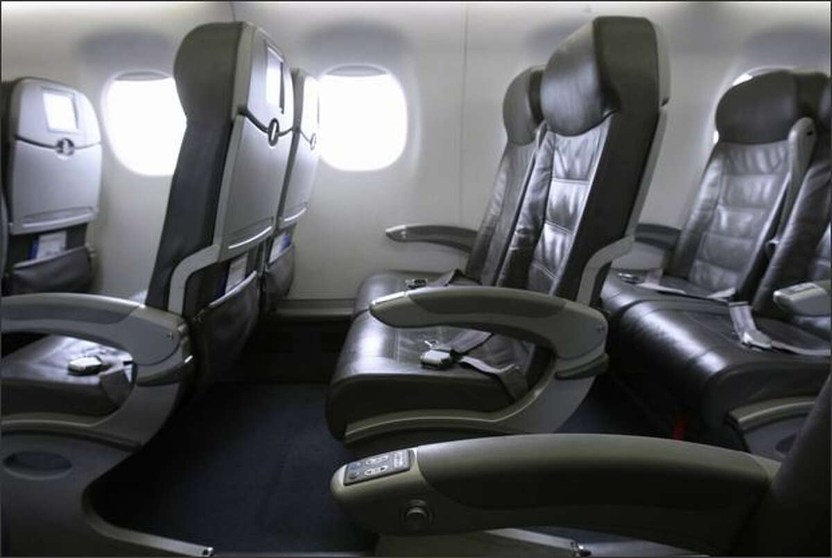 The JetBlue Airways EMBRAER E190 airplane cabin brags the best legroom in coach and no middle seats, with each row consisting of 4 passengers, split into twos by the aisle.